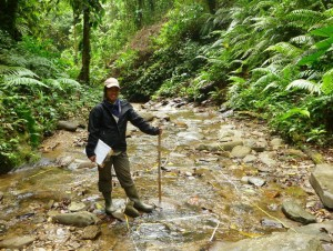 Taking stream morphology measurements in the rainforests of Trinidad.